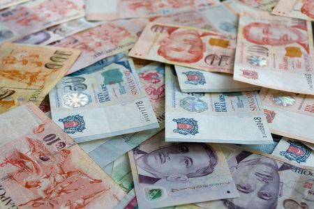 Money background from Various nominal Singapore dollars Stock Photo
