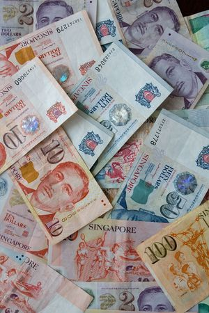 nominal: Money background from Various nominal Singapore dollars Stock Photo