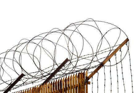 Rusty metallic fence topped with barbed wire isolated = Stock Photo - 5472275