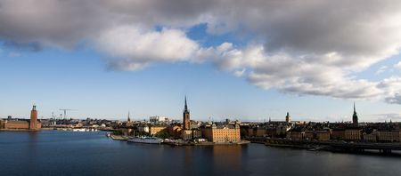 Panoramic view of Stockholm old town. Nice day with blue sky and white clouds photo