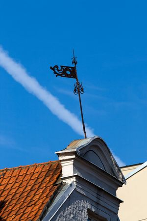 weathercock: Old metalic weather vane against blue sky