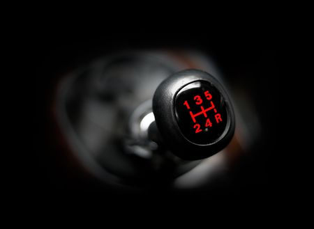 Closeup of a car 5 speed gearstick.