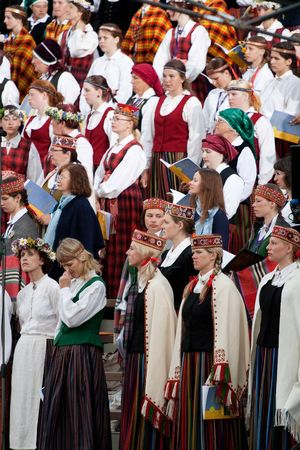 latvia: RIGA - JULY 5: Small part of grand choir singing at Song and dance festival opening concert in Riga , Latvia, July 5, 2008  Editorial