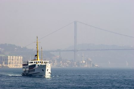 bosporus: Passenger ferry sails between two continents, Europe and Asia in Bosporus Strait, Istanbul, Turkey. Foggy day Stock Photo
