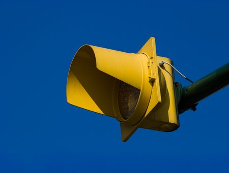 Yellow pedestrian crossing traffic light against deep blue sky. Stock Photo - 6552490