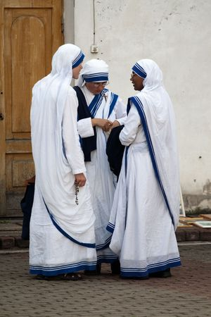 nun: AGLONA, LATVIA - AUGUST 15: Sisters of Missionaries of Charity at the celebration of the Assumption of the Virgin Mary in Aglona, Latvia, August 15, 2008.