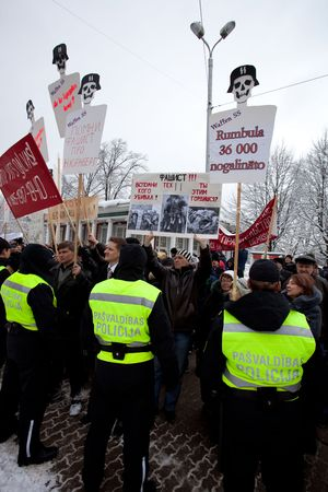 RIGA, LATVIA, MARCH 16, 2010: Protestors shouts against Commemoration of the Latvian Waffen SS unit or Legionnaires.The event is always drawing crowds of nationalist supporters and anti-fascist demonstrators. Many Latvians legionnaires were forcibly calle
