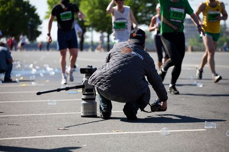 photojournalist: RIGA, LATVIA - MAY 23:  Professional REUTERS photographer in action at Riga International Marathon on May 23, 2010 in Riga. Editorial