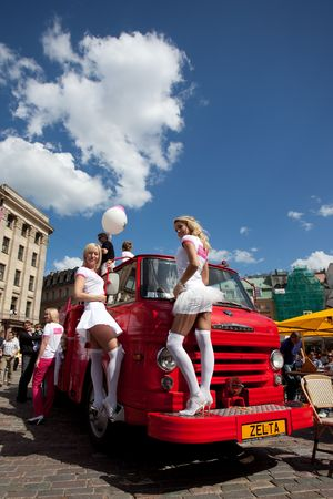 latvia girls: RIGA, LATVIA - MAY 23: Blonde girls posing at retro firefighter car during Go Blonde parade Organized by the Latvian Association of Blonds in May 29, 2010, Riga.  Editorial