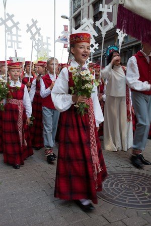 latvia girls: RIGA, LATVIA - JULY 10: A parade by festival participants of Latvian Youth Song and Dance Celebration through the centre of Riga, 10 July, 2010