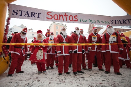 RIGA, LATVIA - DECEMBER 12: Participants of the third annual Santas Fun Run & Walk in Riga, Latvia, 12 December, 2010