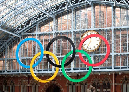 terminus: London, United Kingdom - June 8, 2011: The Olympic rings at St Pancras International Rail Station on June 8, 2011. This station is the terminus of trains in the UK and in France with Eurostar. The huge Olympic rings greet passengers in preparation for the