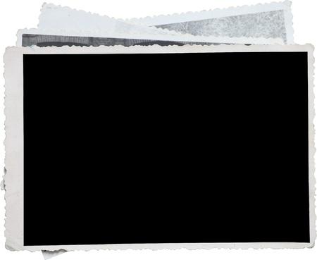 Blank fotolijst op een stapel oude foto's. Uitknippad opgenomen voor Eassy issolation Stockfoto