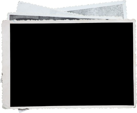 old photo: Blank photo frame on a stack of old photos. Clipping path included for eassy issolation