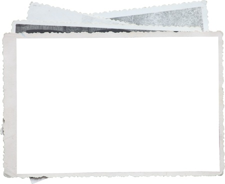 Blank photo frame on a stack of old photos. Clipping path included for eassy issolation