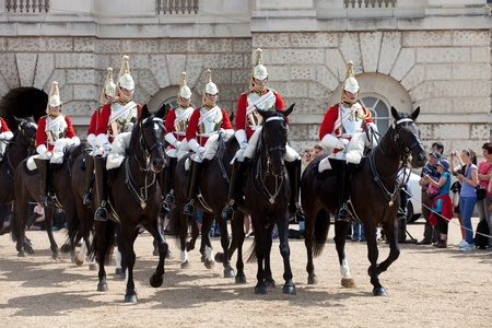 LONDON - JUNE 14: The Queens Life Guard or Horse Guard Changing ceremony in London, UK on June 14, 2011. Guard Mounting Ceremony is held daily during spring and summer on Horse Guards Parade Editorial
