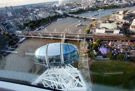 millennium wheel: LONDON - JUNE 10: London city from birds view as seen from London Eye or Millennium Wheel cabin on June 10, 2011, Londun, UK. Millennium Wheel is the tallest Ferris wheel in Europe 135 metre (443ft), and the most popular paid tourist attraction in the U