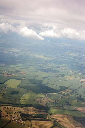 bird's eye view: Aerial view of farmland area landscape from airplane. Photo taken near Stansted (London) airport