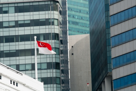 Flag of the Republic of Singapore against office windows