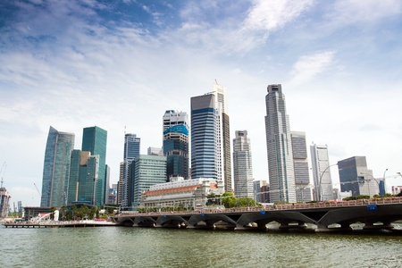 Singapore skyline of financial district with modern office buildings and Merlion Park as seen from Esplanade.