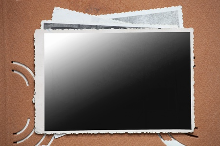 snapshot: Blank photo frame on a stack of old photos. Clipping path included for eassy issolation