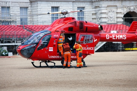 responds: LONDON - JUNE 11: Londons Air Ambulance McDonnell Douglas MD 902 Explorer Helicopter landed in Horse Guards Parade London, England on June 11, 2011. London HEMS (Helicopter Emergency Medical Service) is an air ambulance service that responds to seriously Editorial