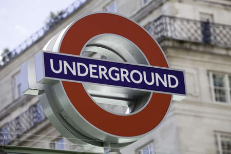 recently: London, United Kingdom - June 8, 2011: London Underground roundel sign against blurred background on June 8, 2011. Recently roundel has been has been applied to other London transport types (taxi, tram, DLR etc.)