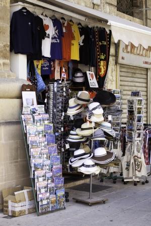 recognised: VALLETTA, MALTA - JUNE 20: Showcase of souvenir shop on June 20, 2011, Valletta, Malta. Malta and Valletta is major tourist destination in mediterranean region. In 1980 Valletta was recognised as a World Heritage Site by UNESCO.