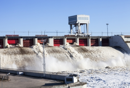 spillway: Spring flood water flowing on hydroelectric power station dam