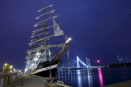 RIGA, LATVIA - JULY 25: Illuminated russian tall ship Kruzenshtern duringThe tall ships races July 25, 2013 Riga, Latvia. Kruzenshtern is  four-masted barque and second largest traditional sailing vessel still in operation