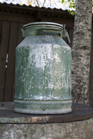 Large old metal milk can photo