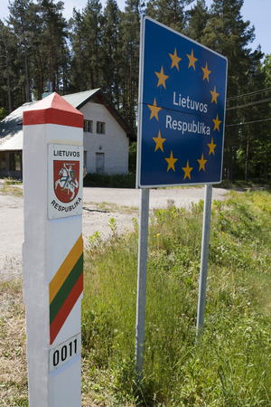 Lithuania country border sign between Latvia and Lithuania with coat of arms and flag