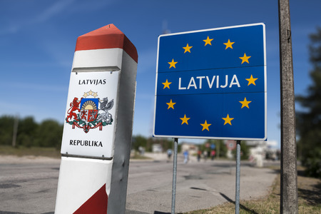 schengen: General Schengen country border sign of Latvia located on the border between Latvia and Lithuania