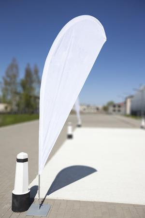 Blank white advertising flag or so called beach flag.