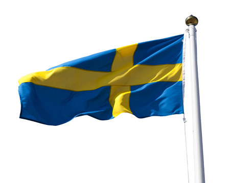 Sweden flag flying in the wind isolated on white with clipping path photo