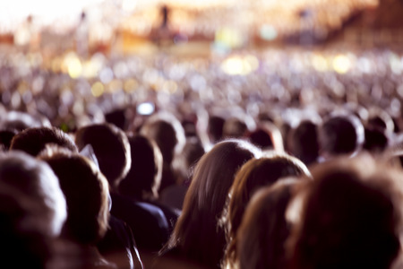 crowd: Large crowd of people watching concert or sport event