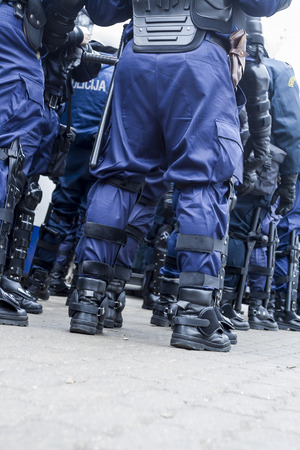 police unit: Unit of police special forces in riot gear waiting for orders.