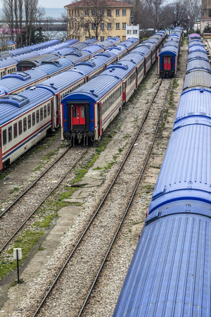 haydarpasa: ISTANBUL, TURKEY - MARCH 20, 2011: Trains with blue roofs waiting in siding tracks at Haydarpasa station, Istanbul