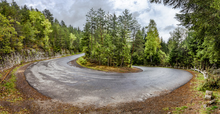curved: Curved serpentine mountain road in romanian carpathian. Panoramic montage from 3 HDR images