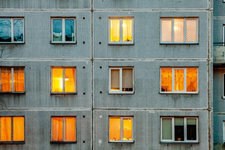 iluminated: Wall with Iluminated windows. Detail of soviet era block apartment building