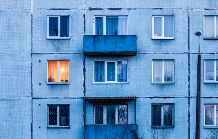iluminated: Wall with Iluminated window. Detail of soviet era block apartment building