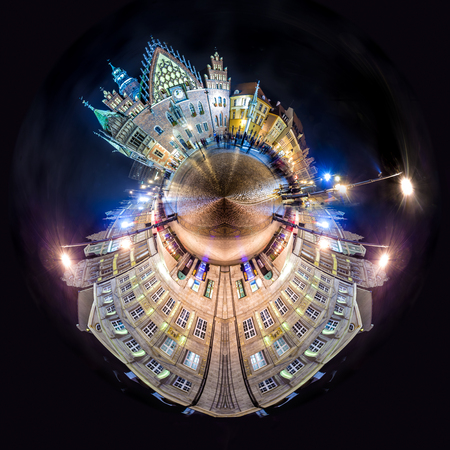 overpopulated: Tiny planet of Wroclaw Market Square with Town Hall. Night scene with long exposure motion blurred people Stock Photo