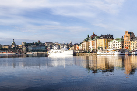 Stockholm daylight skyline panorama of Gamla Stan with white ships Stock Photo