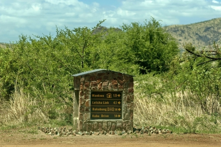 indicative: A stone indicative signboard in Pilanesberg National Park, South Africa Stock Photo