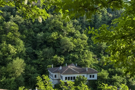 crouched: Old house crouched in forest at Melnik town