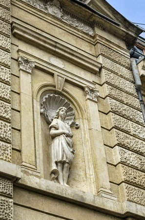 parget: Ancient building from 1891 year with young woman statue in Ruse town, Bulgaria Stock Photo