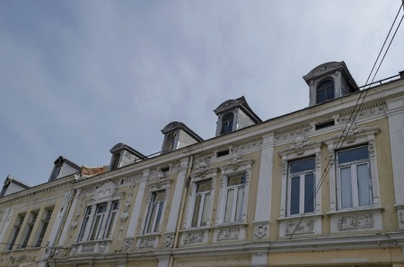parget: Ruse, Bulgaria - October 13, 2014: Ancient partial renovated building in Ruse town
