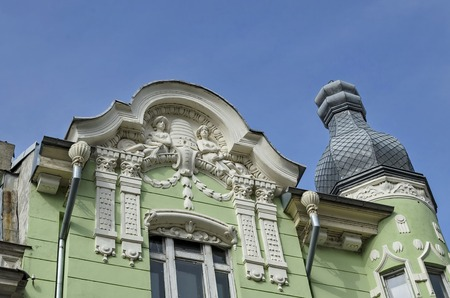 stucco facade: Upper part of building with rich decoration in center of Ruse town