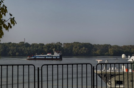 riverside tree: Tugboat pass along the Ruse port at Danube river, Bulgaria Editorial