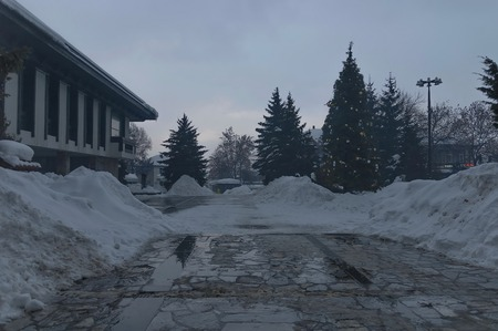 heap of snow: Central square in Bansko town, Bulgaria